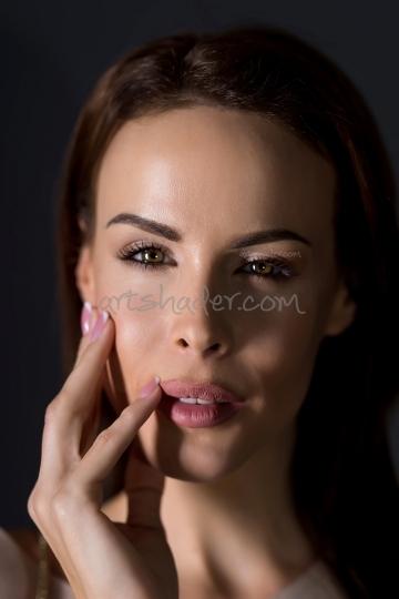 Fashion Portrait of a elegant young woman on a dark background