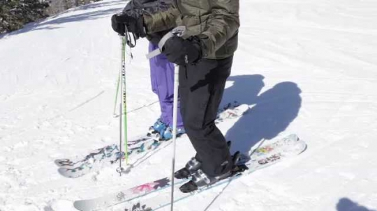 Skiers Remove Skis Close-Up, Look at Mountain View, USA, 2010s