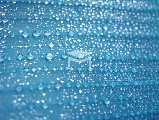 Blue water drops on wet surface