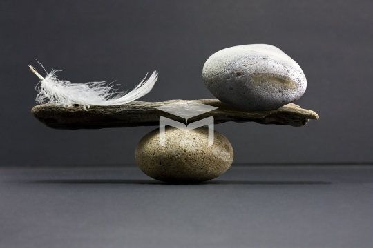 feather and stone balance
