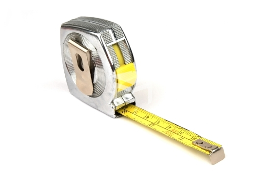measuring yellow tape tool over white background