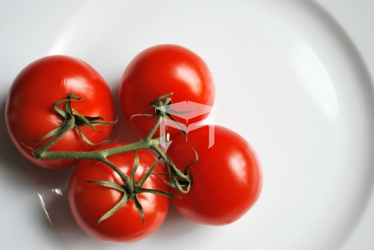 Red cherry tomatoes isolated on white