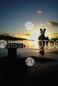 Sunset And Boats In Port Of Tahiti