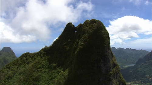 Aerial shot of the top of Mouaputa montain of Moorea in French Polynesia, pierced mountain