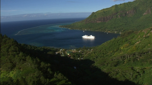 Aerial shot of a cruise ship in the Opunohu Bay of Moorea, in the Society Islands in french Polynesia
