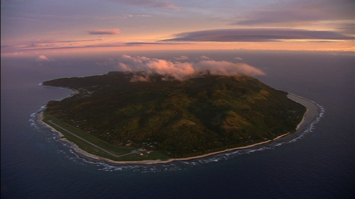 Aerial shot of the island of Rurutu under the sunset lighting, Austral islands in french Polynesia