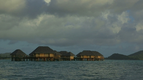 Bora Bora, Over water bungalows in the lagoon , with sunset light
