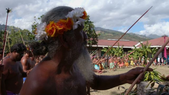 Heiva Tahiti, Traditional sports of Polynesia, old man with flowers crown participating at traditional javelin throwing contest