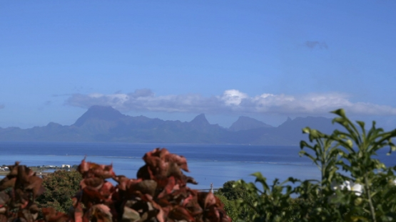 Moorea, panoramic view of the island during the sunny morning, shot from Tahiti