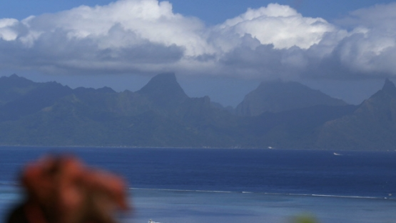 Moorea shot from Tahiti, island under the blue sky