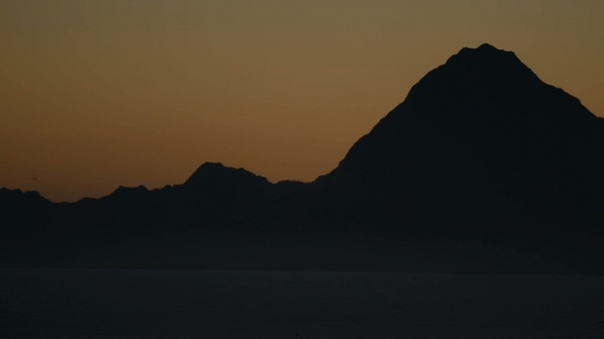 Moorea, panoramic view of nice sunset on the mountain chain of the island, shot from Tahiti