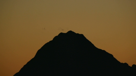 Moorea,  nice sunset on the mountain of the island, shot from Tahiti