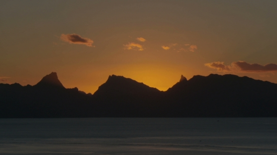 Moorea, Orange sunset on the island, shot from Tahiti