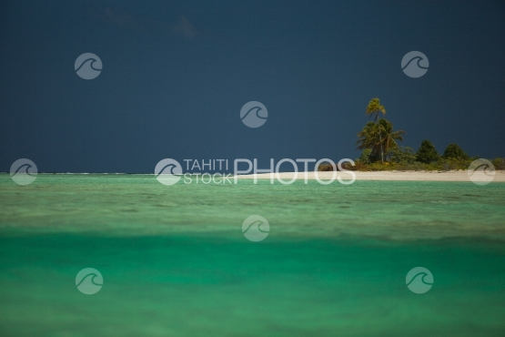 Bora Bora, Small island with coconut trees and white sand beach in the lagoon