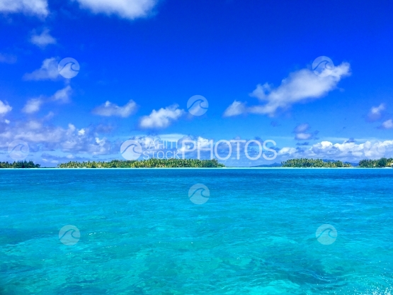 Blue water and Motus in the beautiful lagoon of Bora Bora
