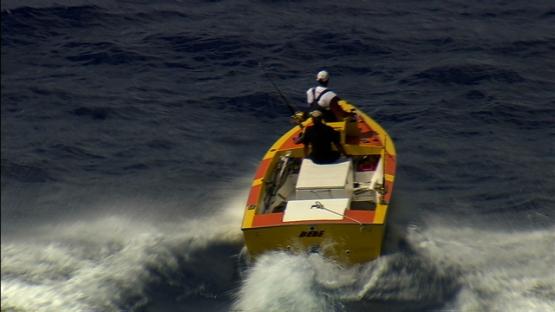 Moorea, yellow fishing boat sailing to the island, poti marara