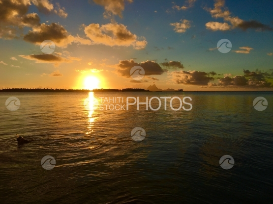 Sunset in the lagoon of Tahaa