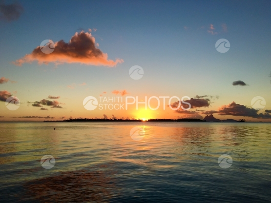 Sunset in the lagoon of Tahaa, Bora Bora, in the background