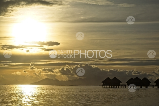 Luxury overwater bungalows in the lagoon and sunset, Moorea in the backyard