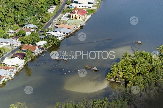 Huahine, aerial view of fisher house in the river