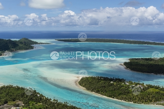 Aerial view of the lagoon and turquoise water of Maupiti