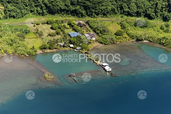 Raiatea, aerial view of island and house in the bay