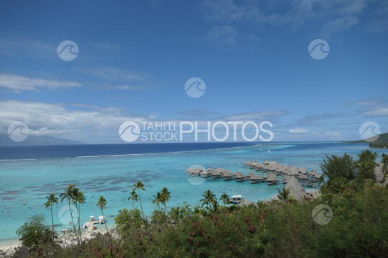 Coast line of Moorea, view on the lagoon and a luxurious hotel