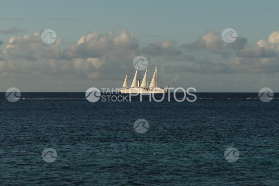 Four masts sail boat on the ocean