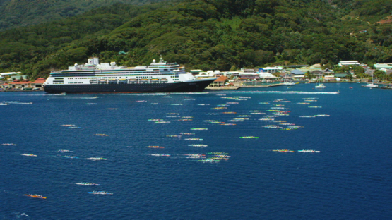 Raiatea, aerial view of the canoes of the Hawaikinui paddle race, and cruise ship at dock