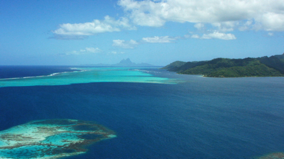Tahaa, aerial view of the island and lagoon, Bora Bora in the background