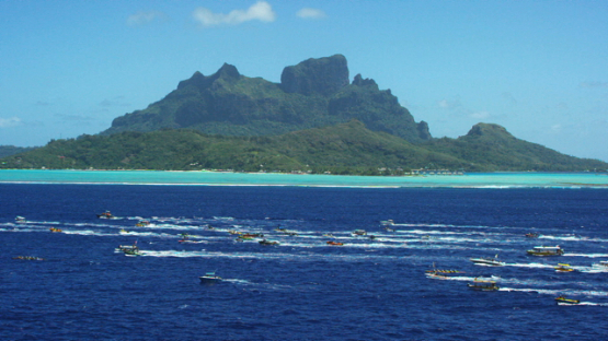 Bora Bora, aerial view of the island and lagoon during Hawaikinui paddle race