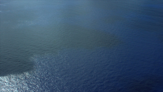 Aerial view of shadows of clouds on the surface of the ocean