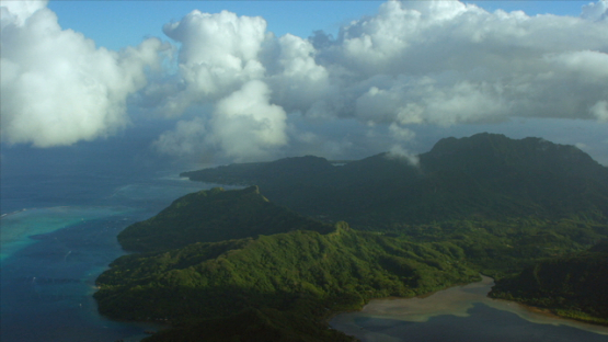 Tahaa, aerial view of the the island under the clouds