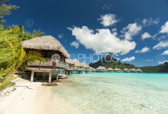 Bungalows of an hotel along the lagoon of Bora Bora