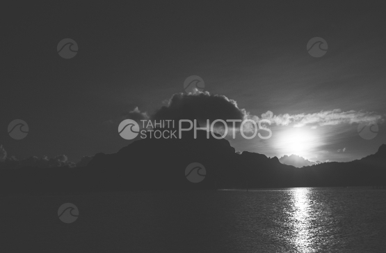 Island and lagoon of Bora Bora at the sunset, shot in black and white