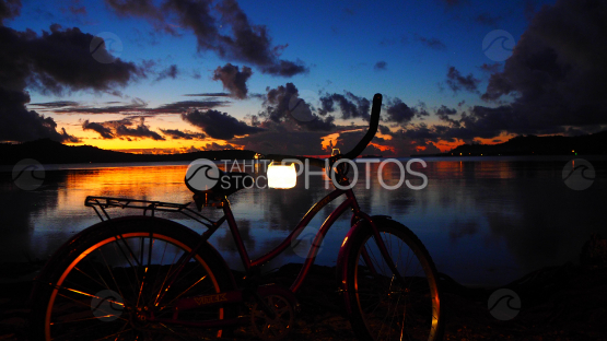 Bicycle by the lagoon of Bora Bora at the sunset