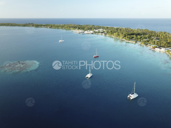 Fakarava, aerial shot of the lagoon and anchored sail boats