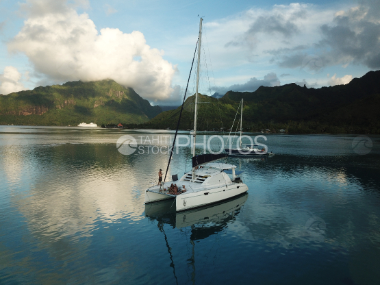 Moorea, sail boats anchored in the lagoon, with passengers on board