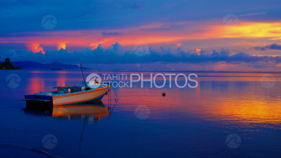 Fishing boat in the lagoon at the Sunrise, Raiatea