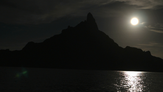 Bora Bora, slow motion, sailing at night in the lagoon, under the moon light