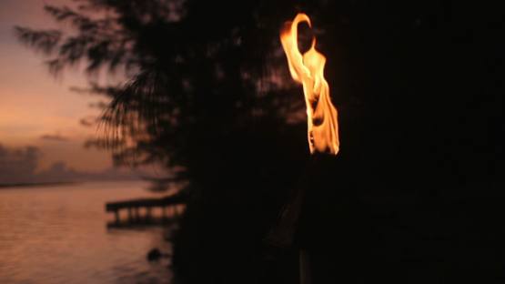 Bora Bora, flame on torch burning on the beach, slow motion