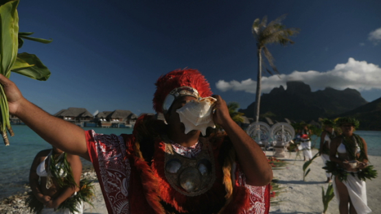 Bora Bora, tahitian priest officiating during traditional wedding, slow motion