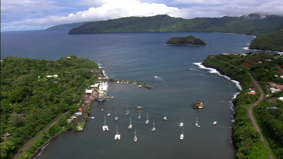 Hiva Oa, Aerial view of a cargo at the pier, Marquesas island