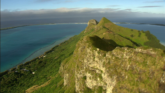 Aerial view of Raivavae, Austral island, over the rocky hills
