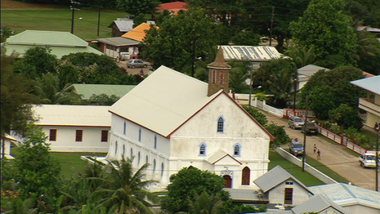 Aerial view of a church in the village of Rurutu, austral islands