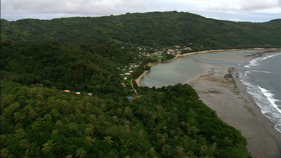 Aerial view of Rurutu and the village by the sea, austral islands