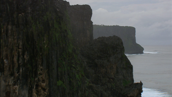 Aerial view of cliffs of Rurutu along the ocean, austral islands
