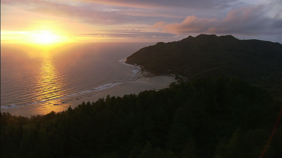 Aerial view of Rurutu and village, during the sunset austral islands