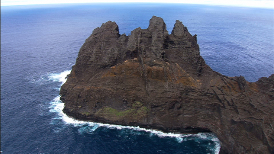 Aerial footage of the rocky coast of Tahuata and ocean, Marquesas islands