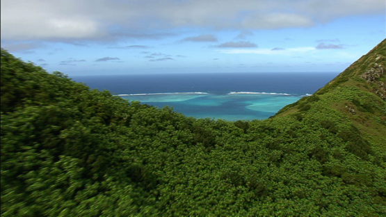 Aerial view of Tubuai, Austral islands, flying over the hills
